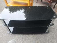 Black glass TV table with shelves