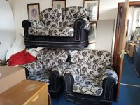 Black and Grey 2 Seater sofa and 2 Armchairs