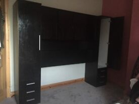 Black gloss large wardrobe and overbed storage unit.