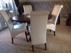 wenga dark wood ding table with four ivory leather chairs