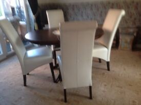 wenga dark wood dining table with four ivory leather chairs
