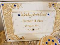Wedding guest book and candles