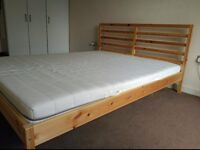 big double bed with mattress and slatted bed base