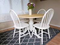 Beautiful solid pine round extending dining table and 4 chairs