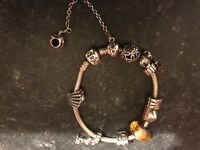Pandora bracelet with ten charms and safety chain £115Ono Px offers swaps
