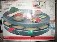 Raclette Grill with 8 coloured pans - NEVER USED