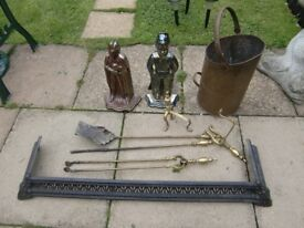 two cast iron companion sets .brass firedogs and companion set . copper coal bucket and fire fender