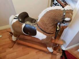 Mama's and papa's wooden rocking horse