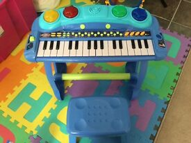 Toy piano and stool