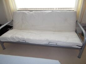 Sofa Bed. Cream with metal frame. Easily converts from sofa to double bed.