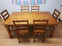 Large solid dining table with 6 chairs