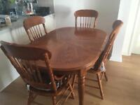 Solid oak extending dining table and chairs. Inc 6 chairs (2 carvers)