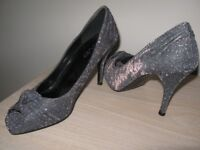 Ladies high heeled shoes, wedges and flats