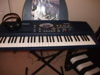 ROLAND creative electric keyboard with stand EM10 with Phillips headphones.