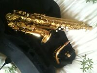 Alto Saxophone, with mouthpiece and shaped case. Superb condition.