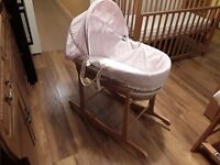 Beautiful moses basket with rocking stand and changing mat