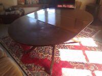 Georgian style drop leaf dining table.