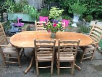 Large solid wood dining table and 6 chairs 8 seater