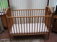 pine wood drop side baby`s cot in excellent condition complete with as new mattress