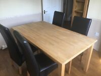 Solid oak dining table & 4 faux brown leather chairs excellent condition