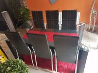 Glass dinning table with 6 chairs £85