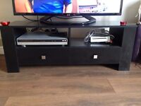 Black TV stand in good condition. 120cm long x 39cm wide x 42 cm high.