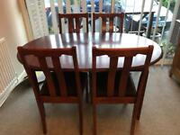Mahogany extending dining table and four chairs