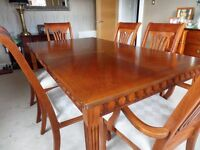 Traditional Rosewood Dining table with 6 chairs with cream upholstery and matching sideboard