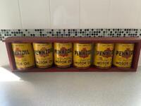 Vintage oil cans display
