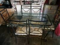 Cast iron dining room table and 6 chairs