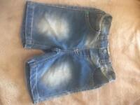 4 pairs of boys shorts size 18-24months