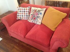 Vintage red sofa and armchair