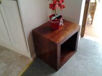 Dark wooden cube shape coffee table.