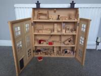 Wooden dolls house, furniture and family