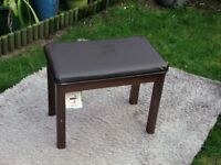 wooden stool with leather look top.60cm long by 36cm wide by 50cm wide