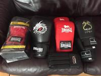 Various sparring gloves and training aids