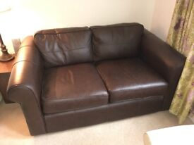 Superb two seater brown leather sofa by Thomas Lloyd. As new.