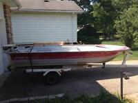 14 foot fiberglass boat w/ 15hp outboard and trailer