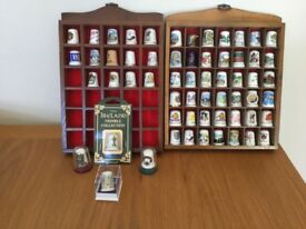 Sixty assorted finger thimbles and two wooden display cases