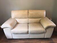 Cream leather suite. 2 seater plus reclining armchair