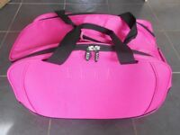 Pink wheeled holdall, ideal for holiday