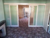 Sliding internal glazed doors