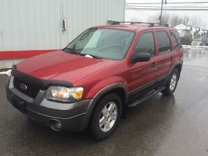 2006 Ford Escape XLT  4WD 3.0L V6 2450$ 514-692-0093