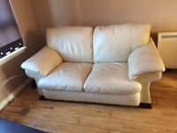 Cream leather two seater sofa with fire tags