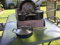 AnolonTitanium Cookware 4 Pieces new,still in boxes .