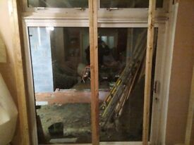 2 Nearly new patio sliding doors 2.4m height x 1.7 wide