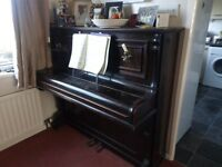 Upright Piano with Candelabras