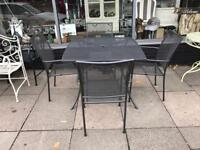 Grey Mesh Table and Four Chairs