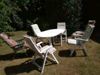 Patio table and six reclining chairs