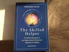 The Skilled Helper by Gerard Egan, 7th edition
